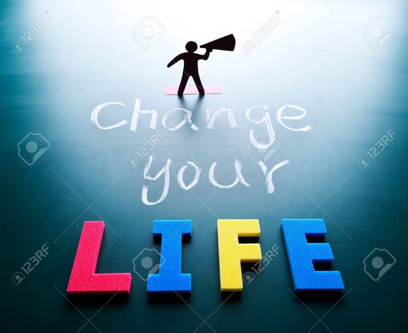 Change your life concept, man and words on blackboard Stock Photo - 17478343
