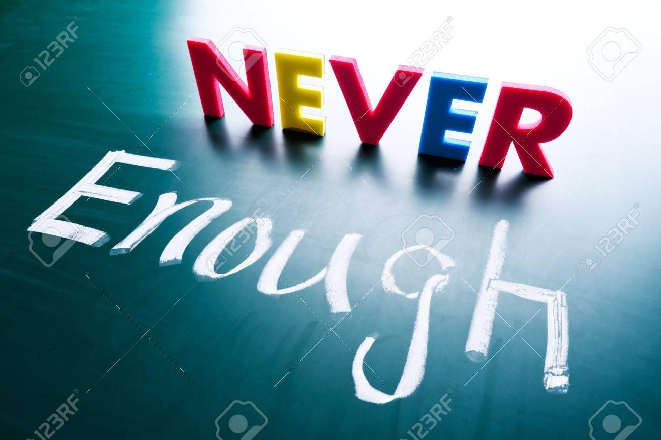 Never enough, conceptual words on blackboard Stock Photo - 18595255