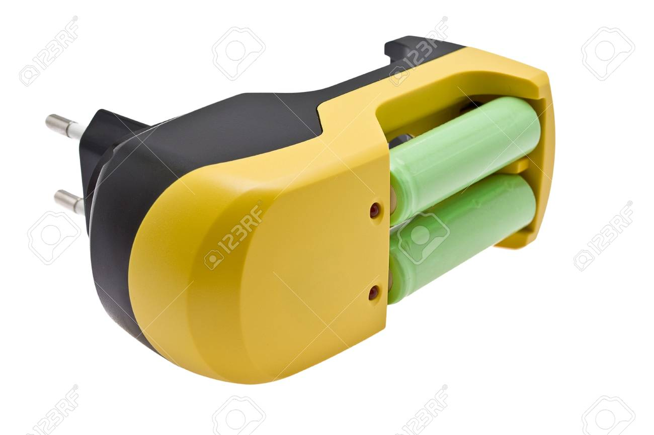 device for a charge of batteries, with the inserted green accumulators Stock Photo - 5691496
