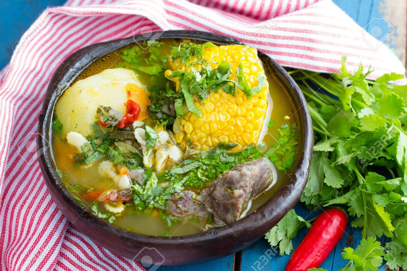 Latinamerican food. Cazuela - traditional chilean latinamerican soup served in clay plate from pomaire - 57253270