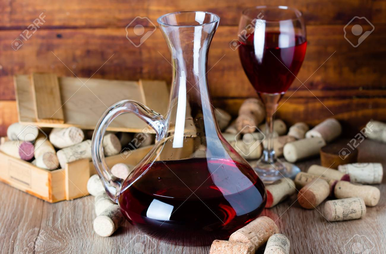 Background with glass of wine, decanter and wine corcs. Wine concept - 57750744