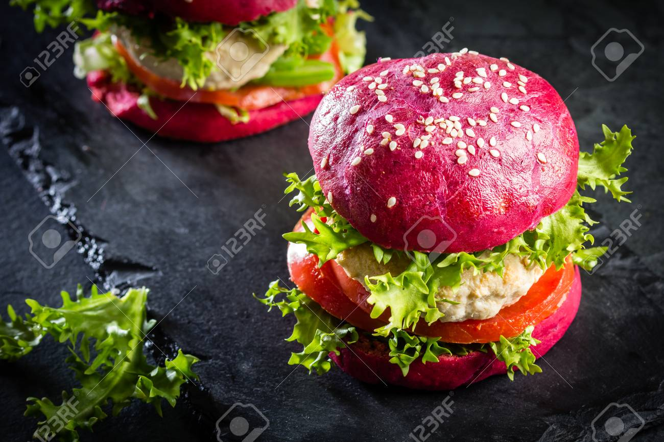 Colored purple beetroot buns and chicken burgers. - 81361139