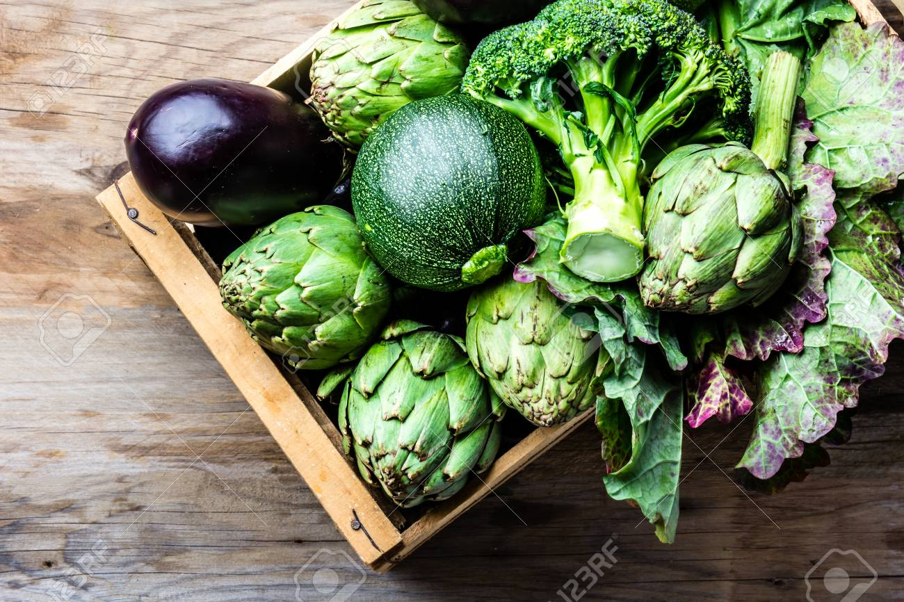 Cooking background harvest concept. Fresh organic green vegetables in wooden box - 81479671