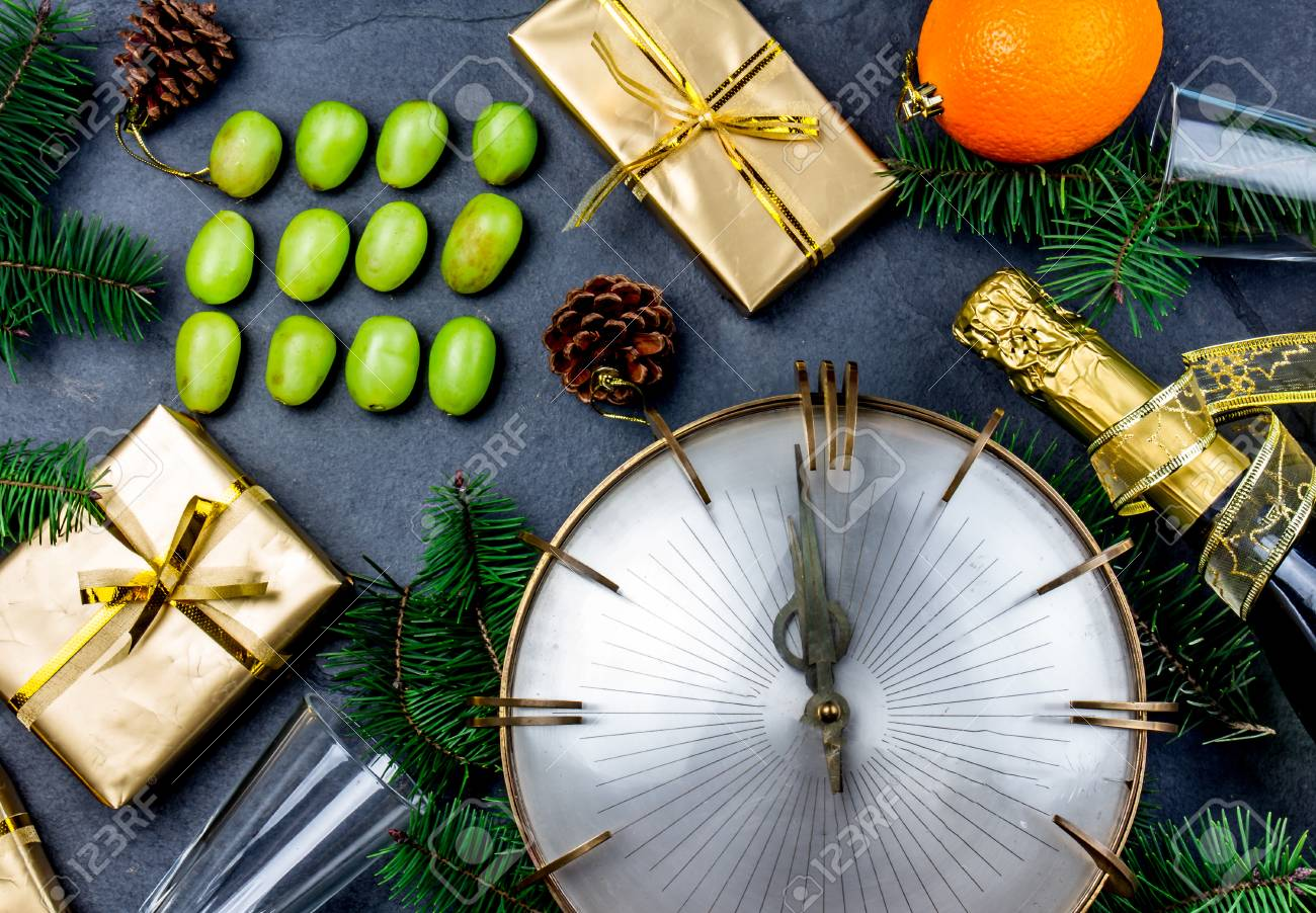 NEW YEAR TRADITION. Latin American and Spanish New Year traditional. Funny ritual to eat twelve 12 grapes for good luck at midnigth. Flat lay, top view. Christmas New Year composition. - 88455631