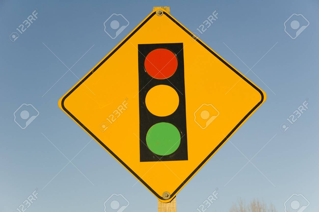 This image shows a vibrante sign that warns cars of oncoming traffic lights Stock Photo - 788360