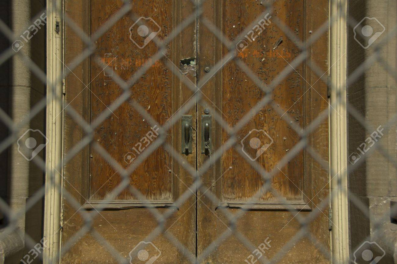 Old door behind chainlink fence Stock Photo - 834111