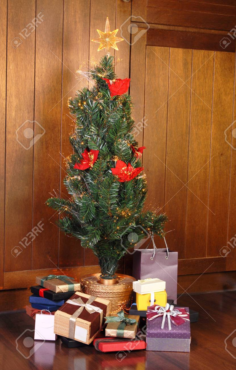 Christmas tree with many colorful gifts Stock Photo - 8217494
