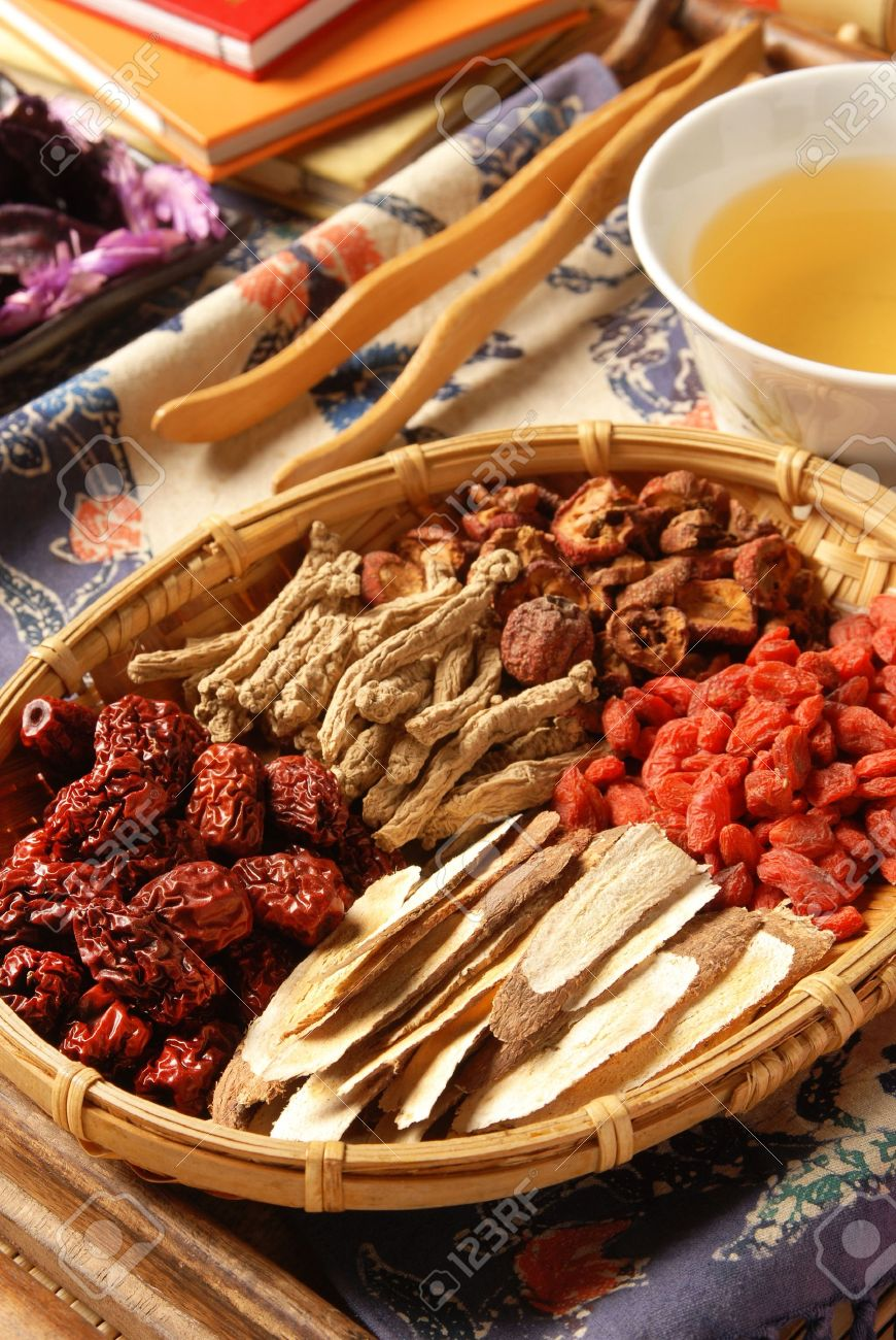Different kind of Chinese herbal medicine on wicker baskets - 8551794