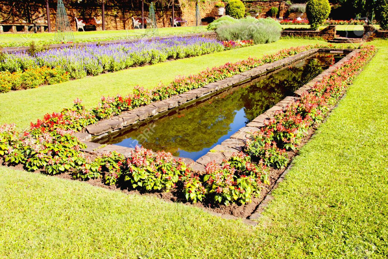 Exceptional Landscaped Formal Garden With Rectangular Fish Pond Stock Photo   24808544