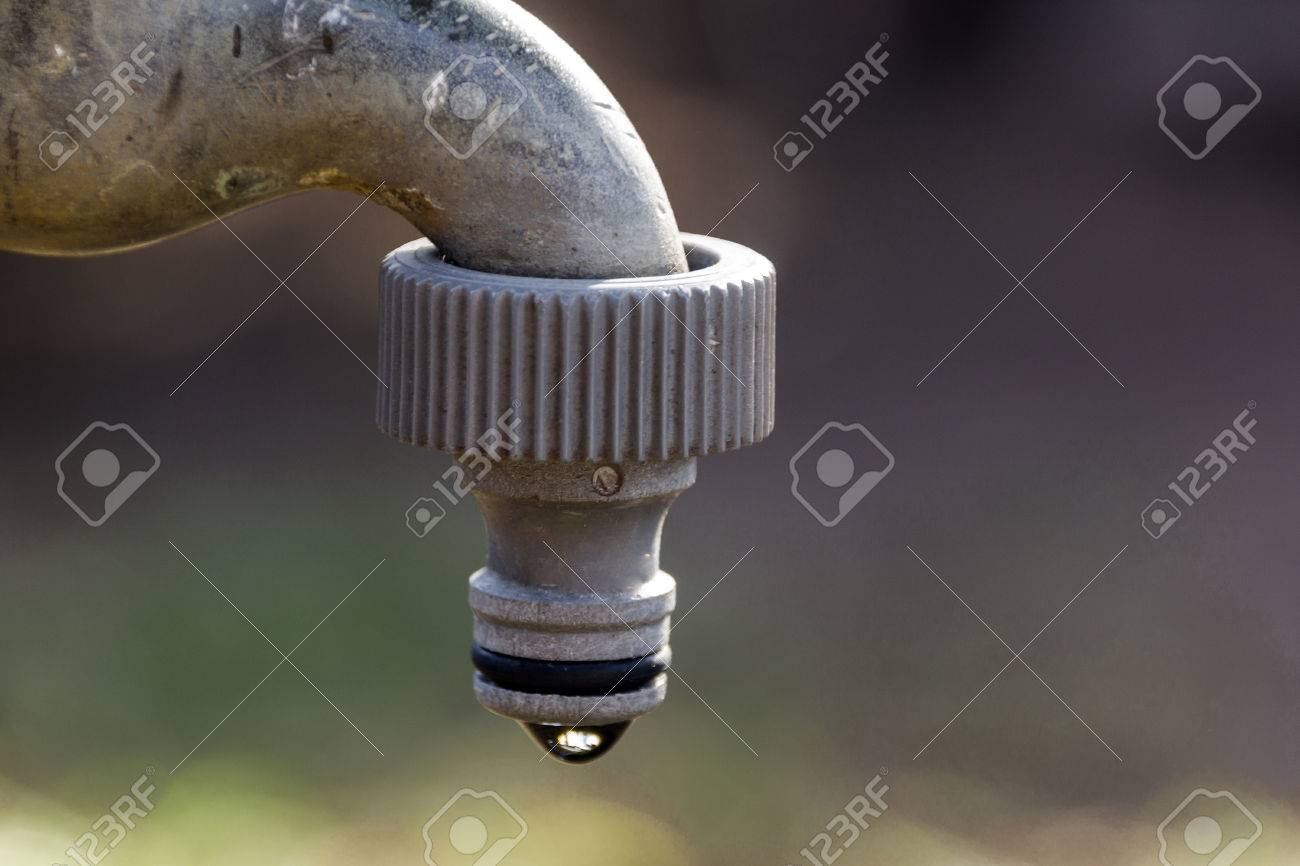 Close Up Of Old Leaking Garden Faucet With Hose Pipe Connection ...