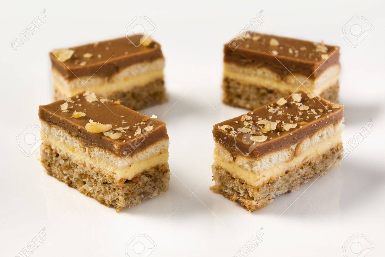Pieces Of A Chocolate And Vanilla Pudding Cake With Walnuts Biscuit