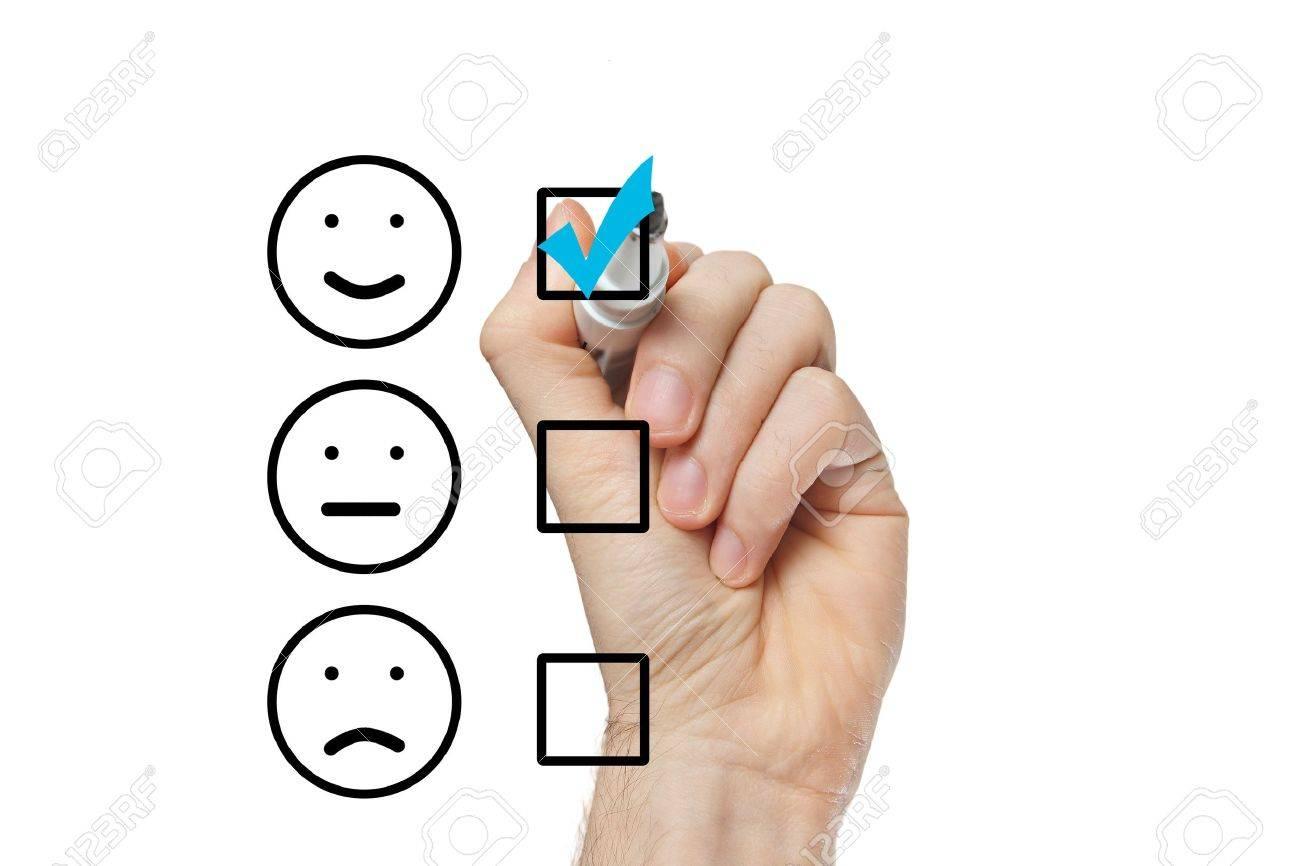Hand putting check mark with blue marker on customer service evaluation form Standard-Bild - 22178947
