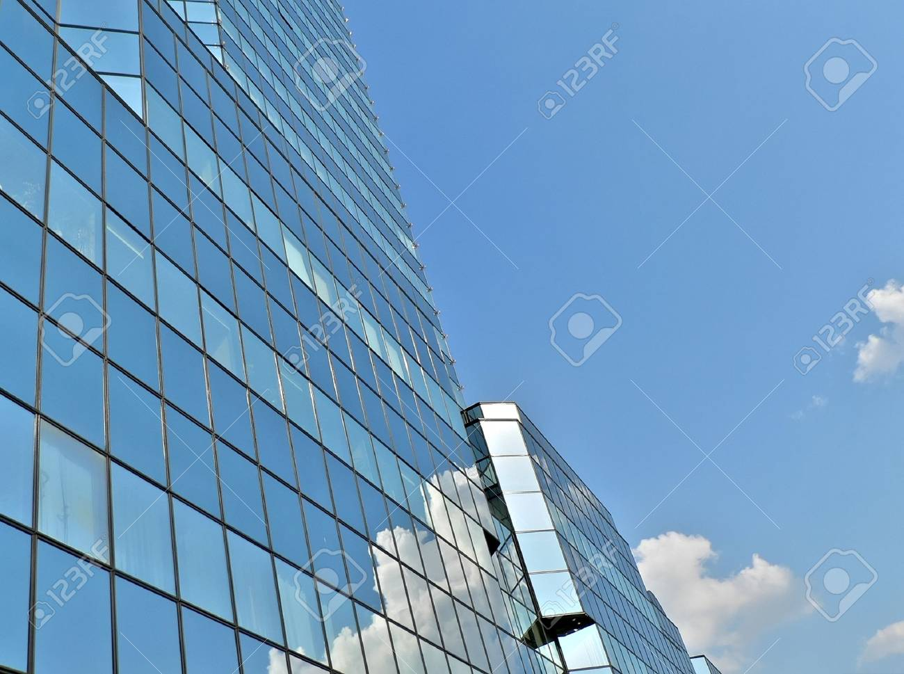 blue building in warsaw with clouds reflection Stock Photo - 1312970