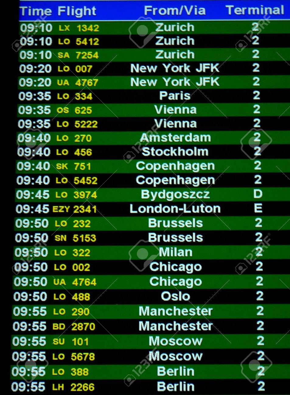 Airport departures screen in Warsaw Poland Stock Photo - 1415274