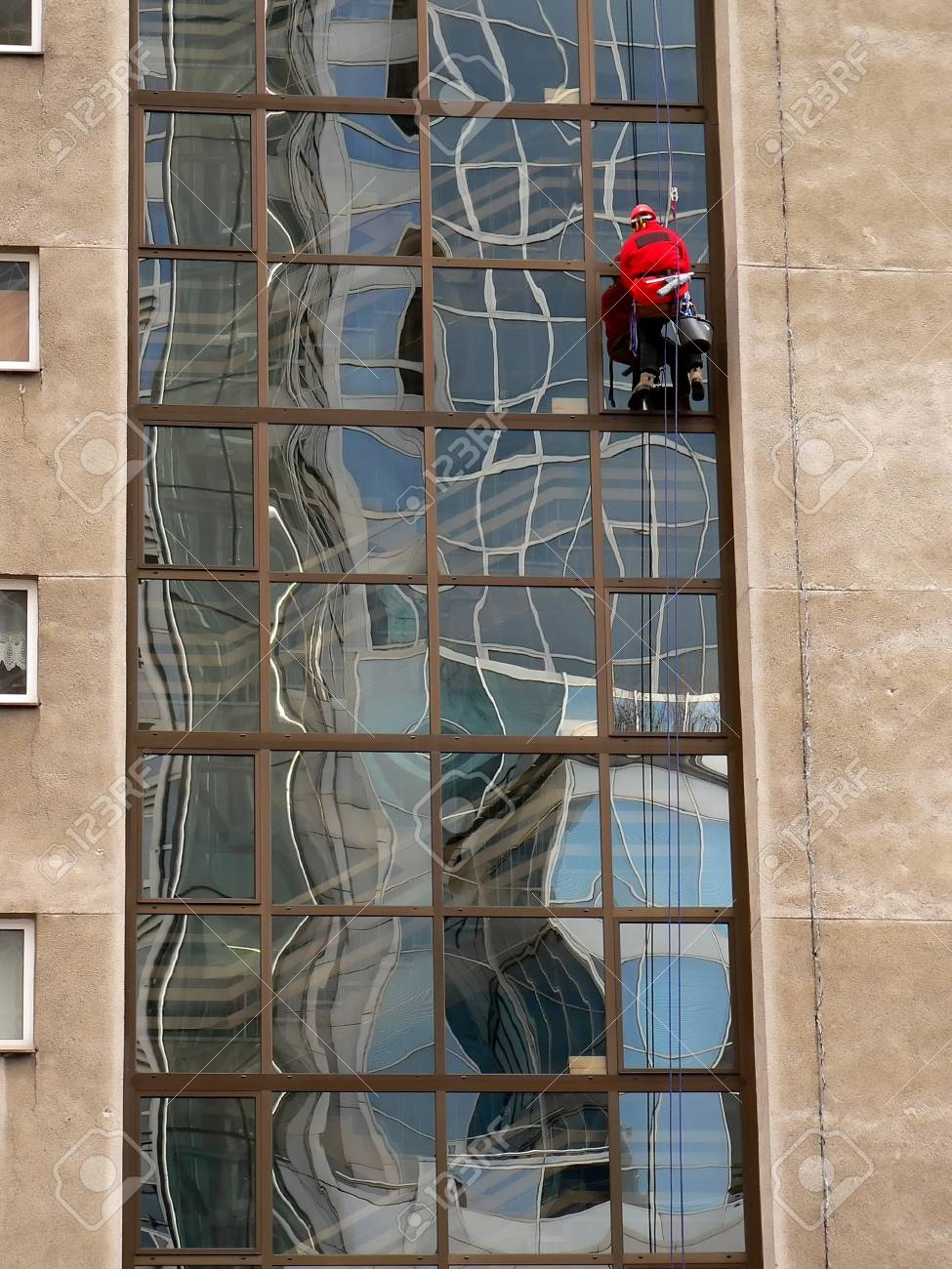 windows cleaner in the city of Warsaw in Poland Stock Photo - 1684581
