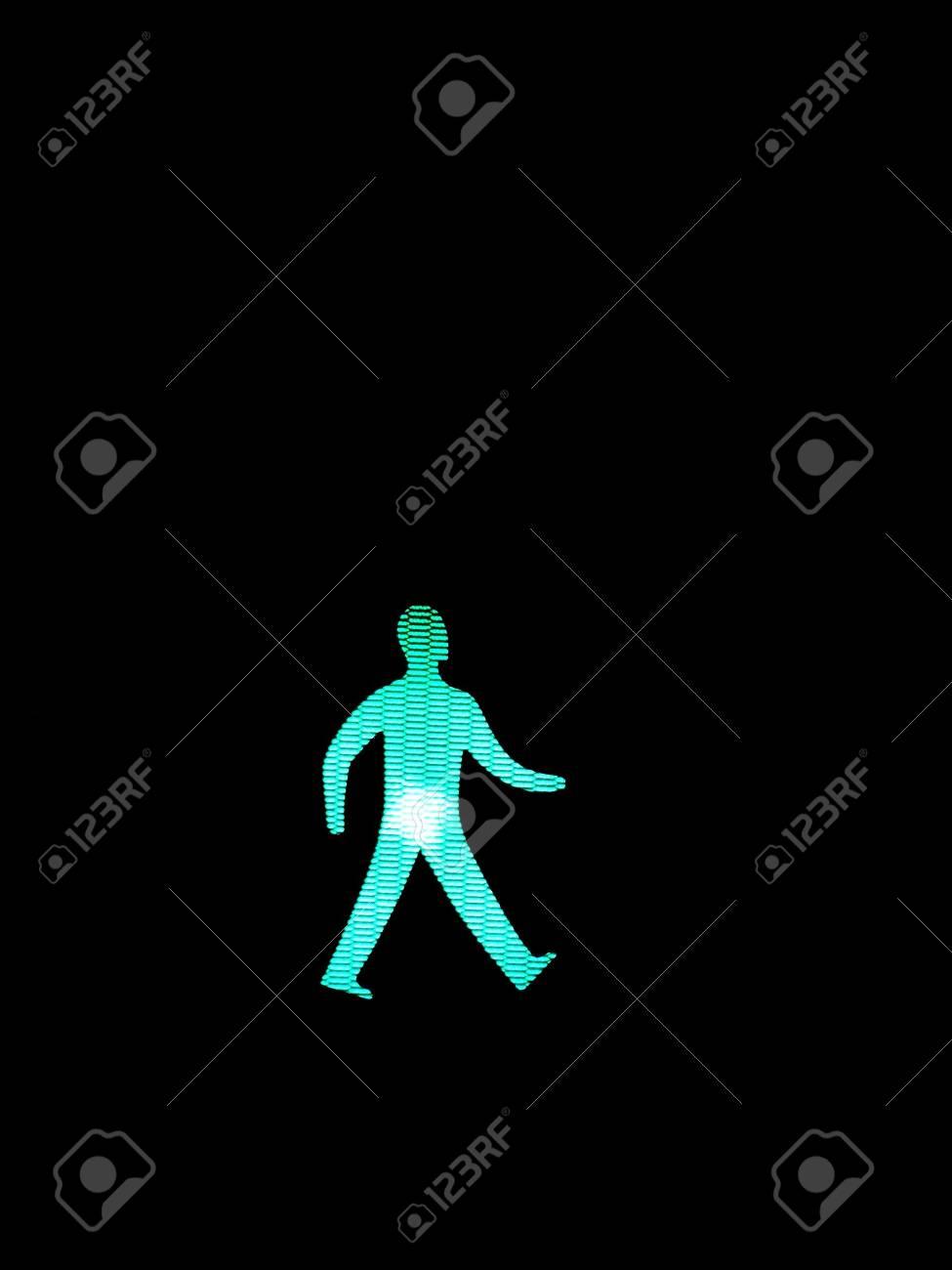 green pedestrian sign on traffic light in scotland Stock Photo - 2131363