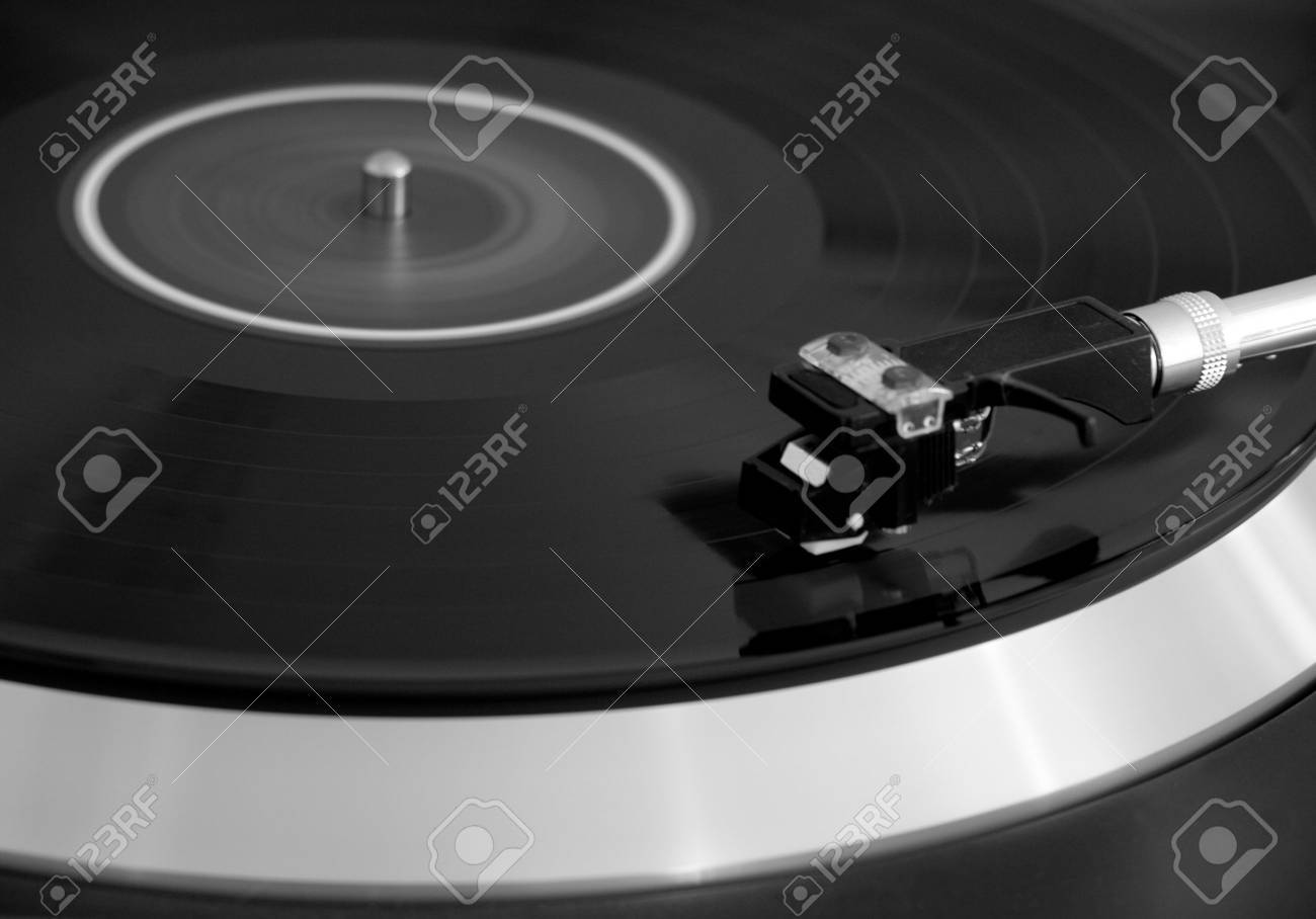 Vintage turntable player with vinyl spinning Stock Photo - 2606598