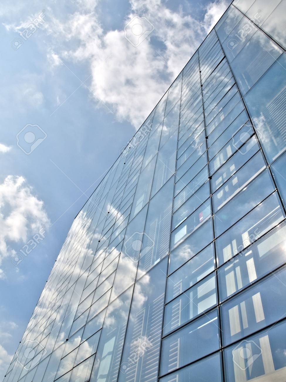 Blue office building with clouds reflection Stock Photo - 3606028
