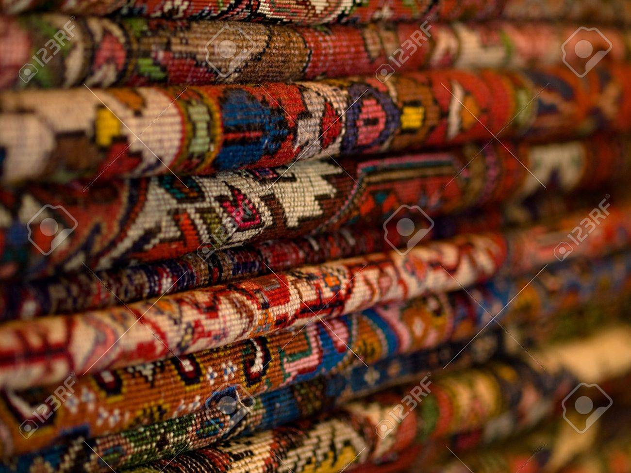 Closeup of a stack of colorful persian carpets with shallow depth of field Stock Photo - 4085052