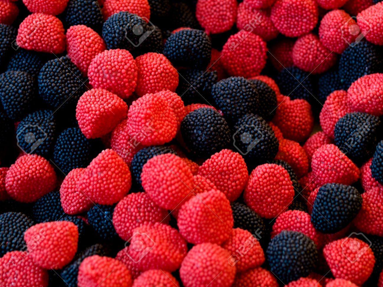 macro of black and red candy fruits stock photo picture and