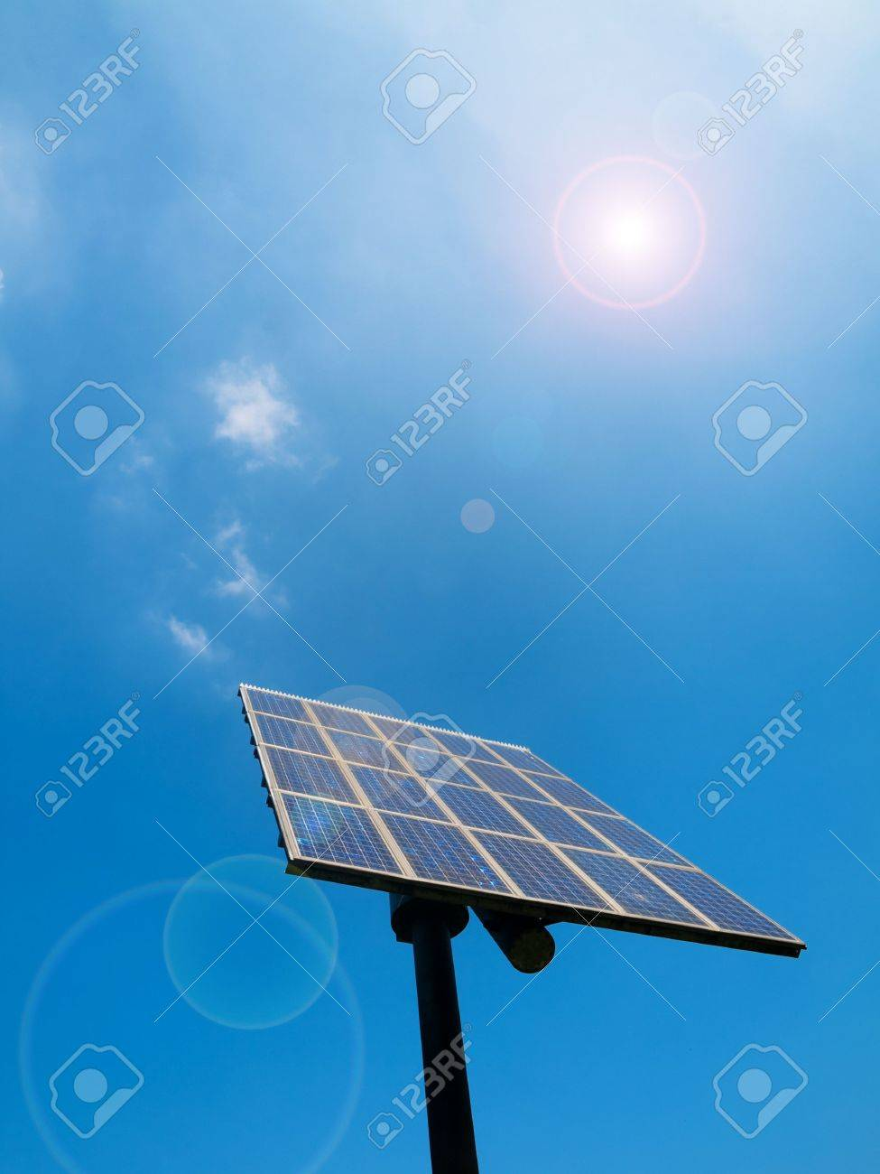 Solar panel under blue sky with sun flare Stock Photo - 5123122