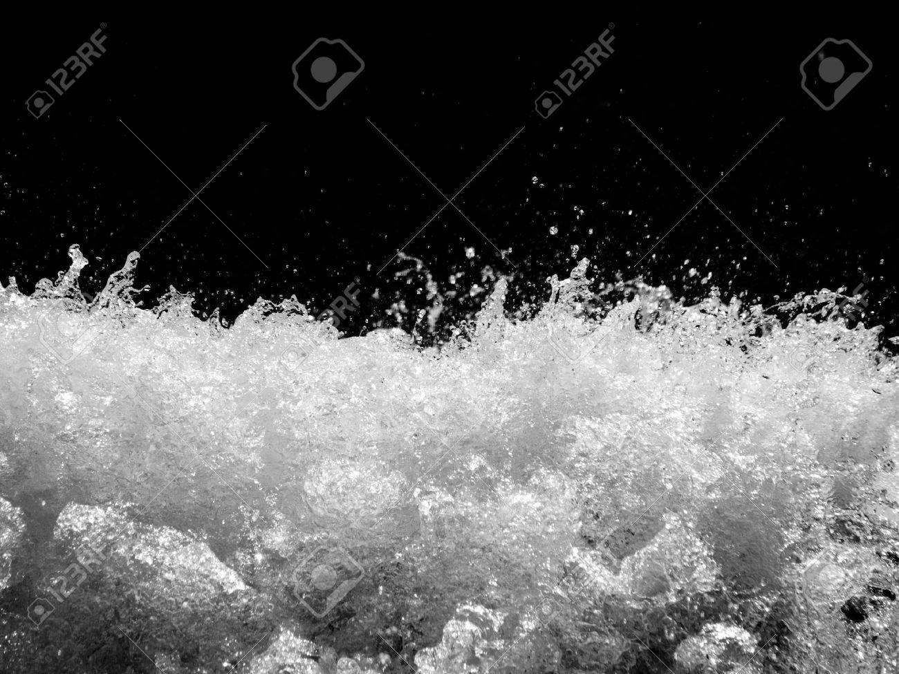 Powerful stormy river with water drops captured on black background Stock Photo - 5508436