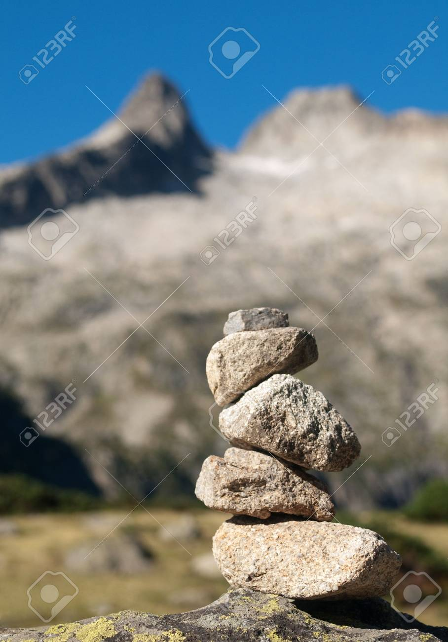 Pile of stones indicating a trail in the mountains Stock Photo - 5542791