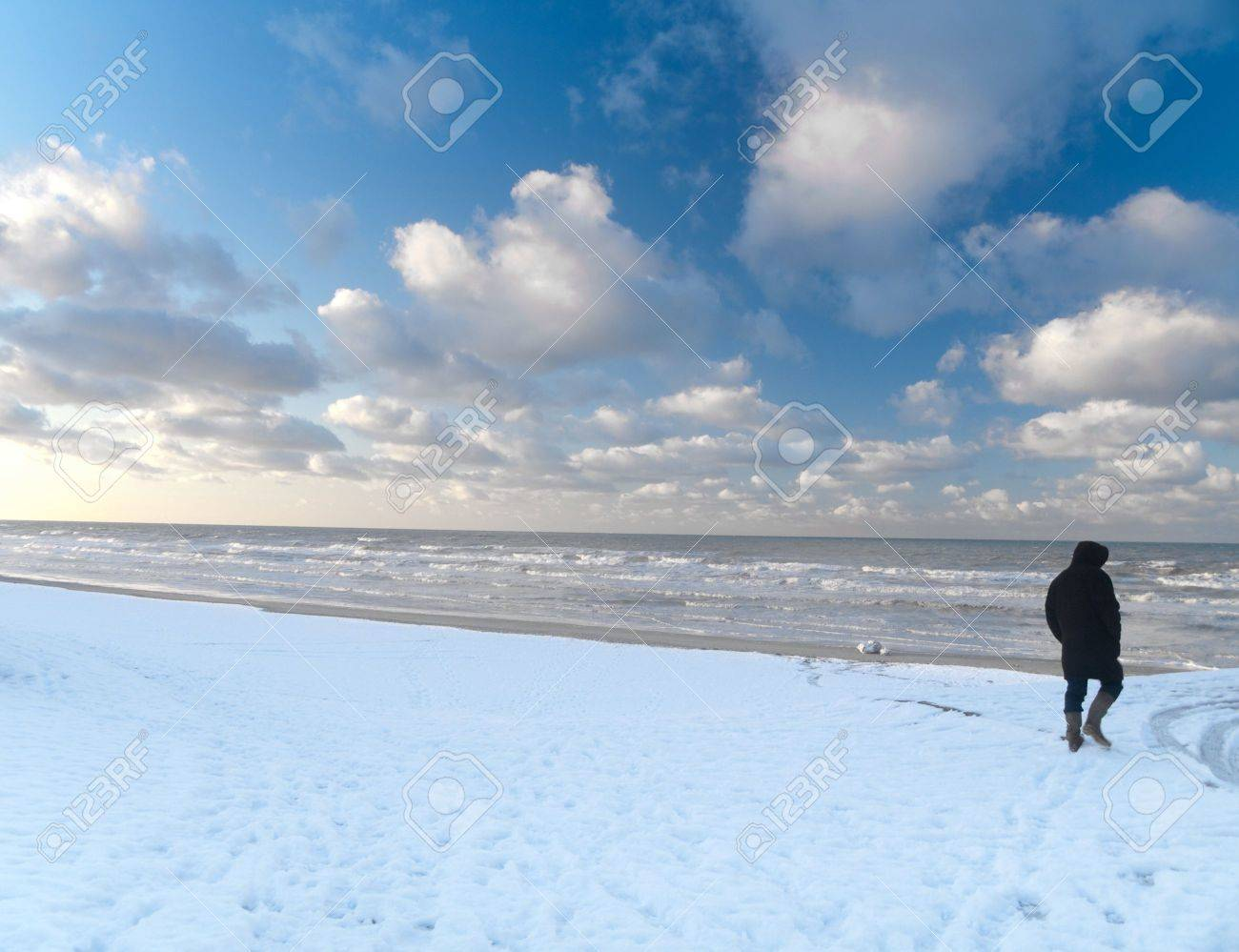Man walking in snowy beach along the North sea in France Stock Photo - 6330489