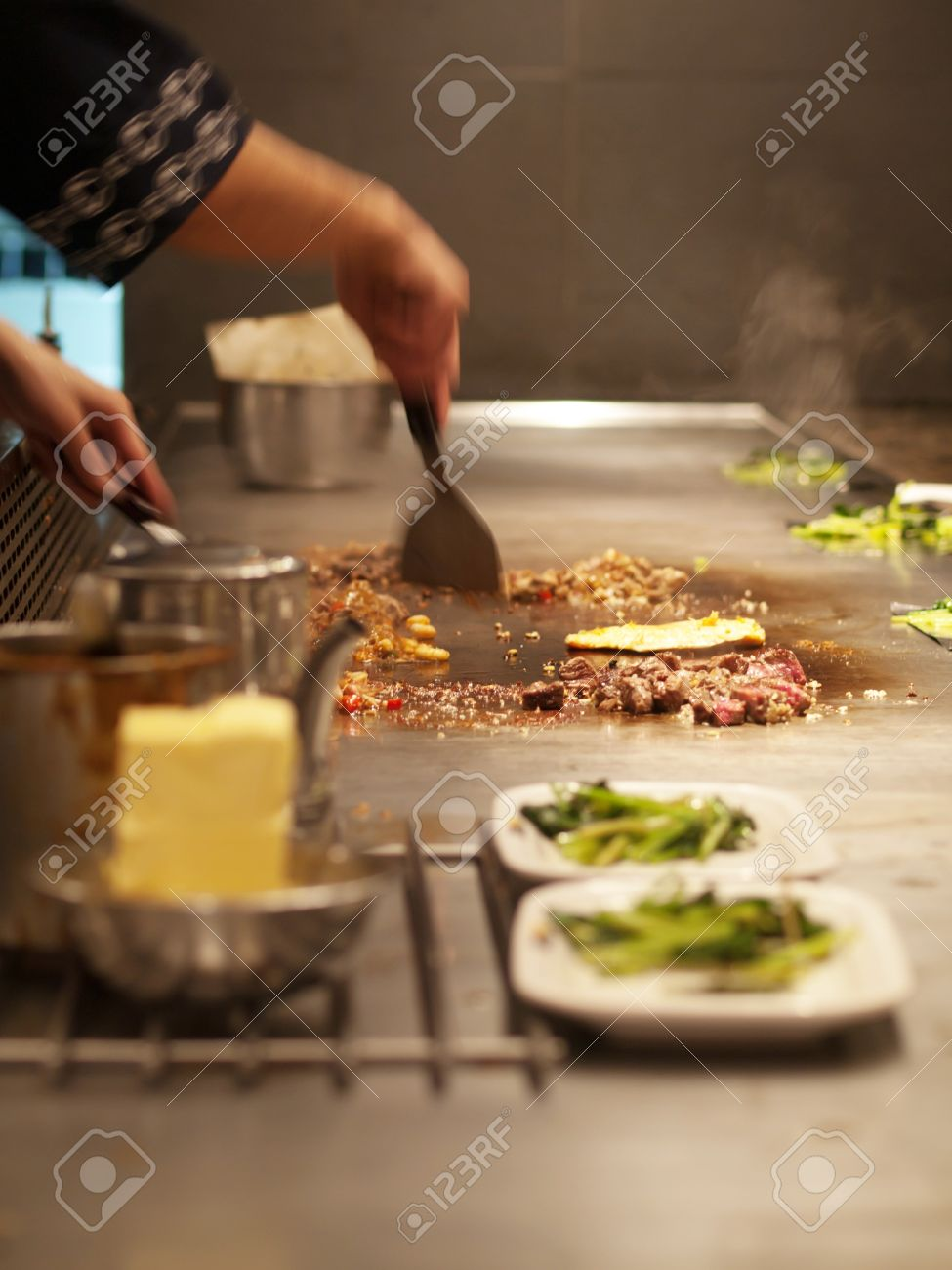 Chef Cooking Meat On A Hot Plate In A Japanese Grill Restaurant Stock Photo Picture And Royalty Free Image Image 7352111