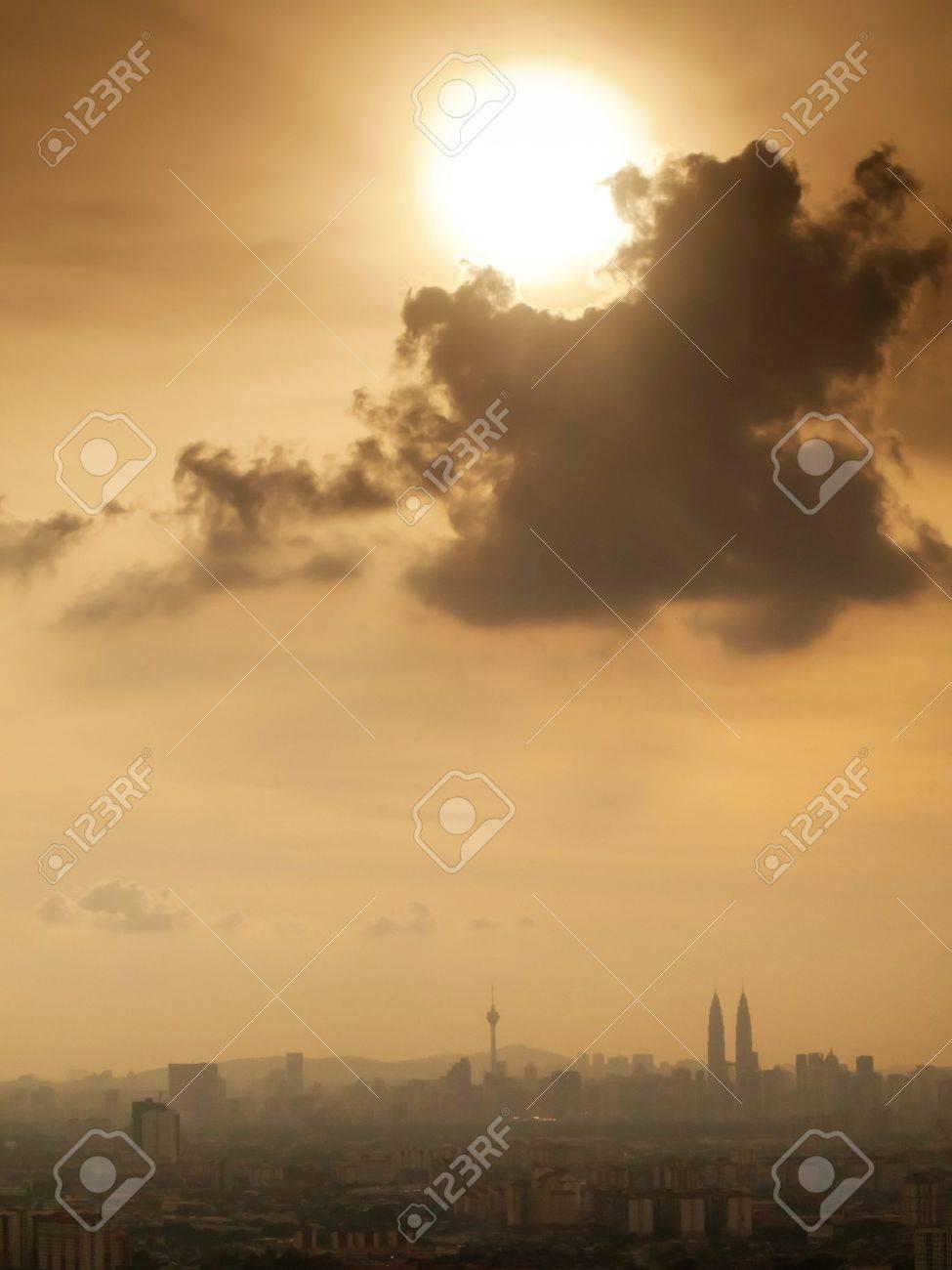 Kuala Lumpur skyline under dramatic sky with shining sun Stock Photo - 7595896