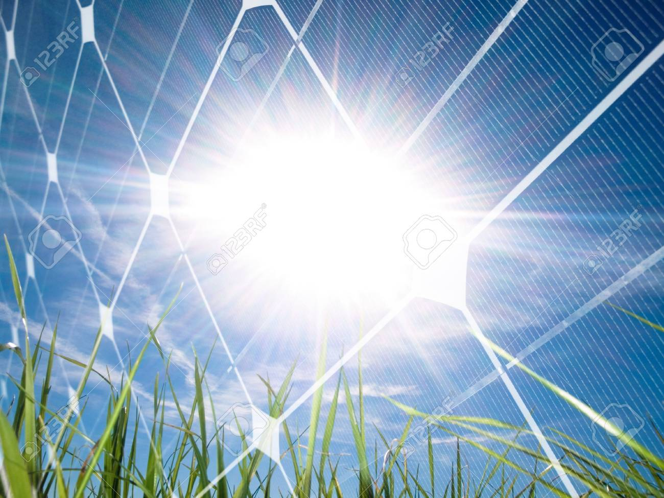 Beautiful grass field at spring against the sun with photovoltaic panel Stock Photo - 7856232