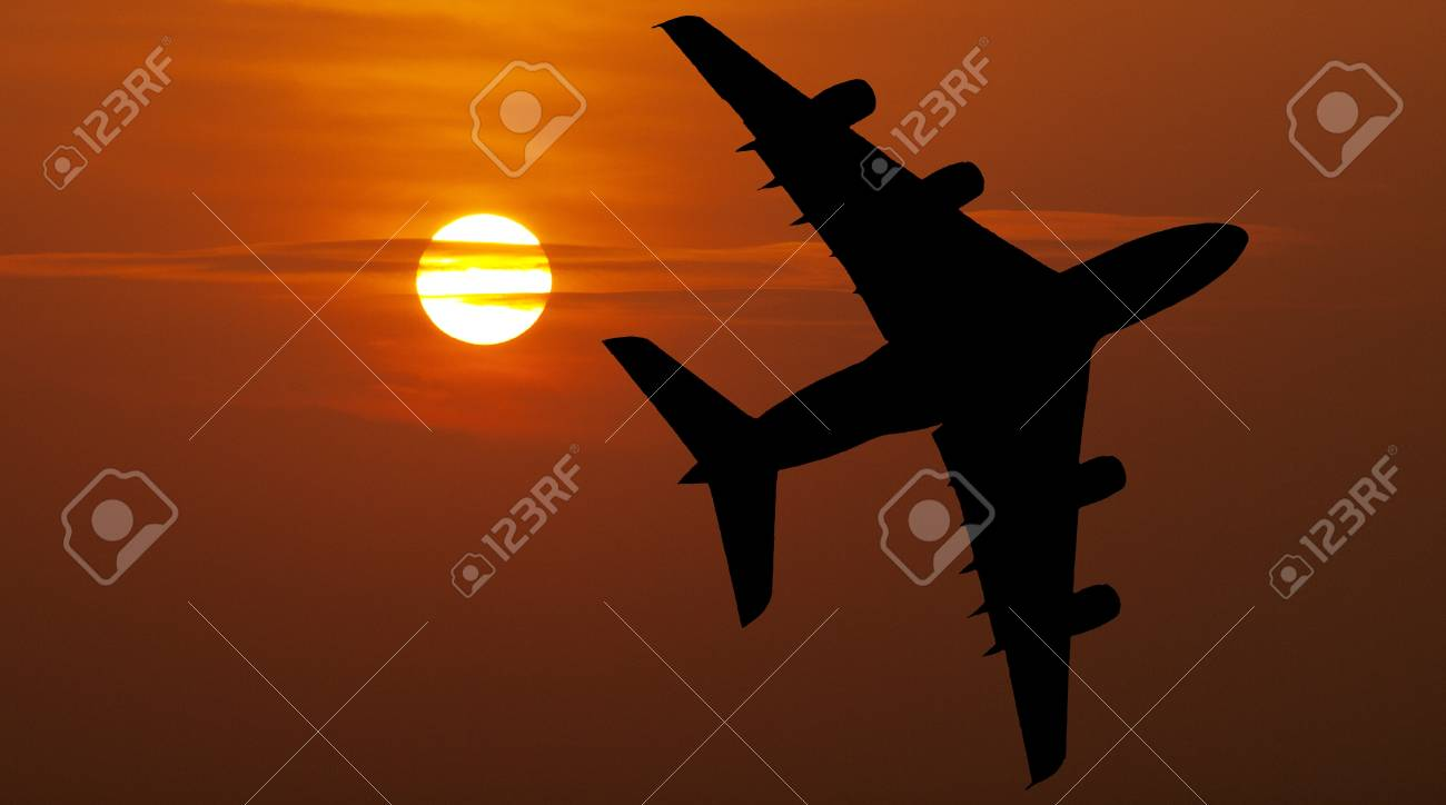 Airliner over red sunset Stock Photo - 10358823