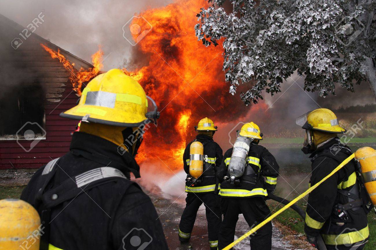 Firefighter at work on an abandoned house in flame Stock Photo - 2100545