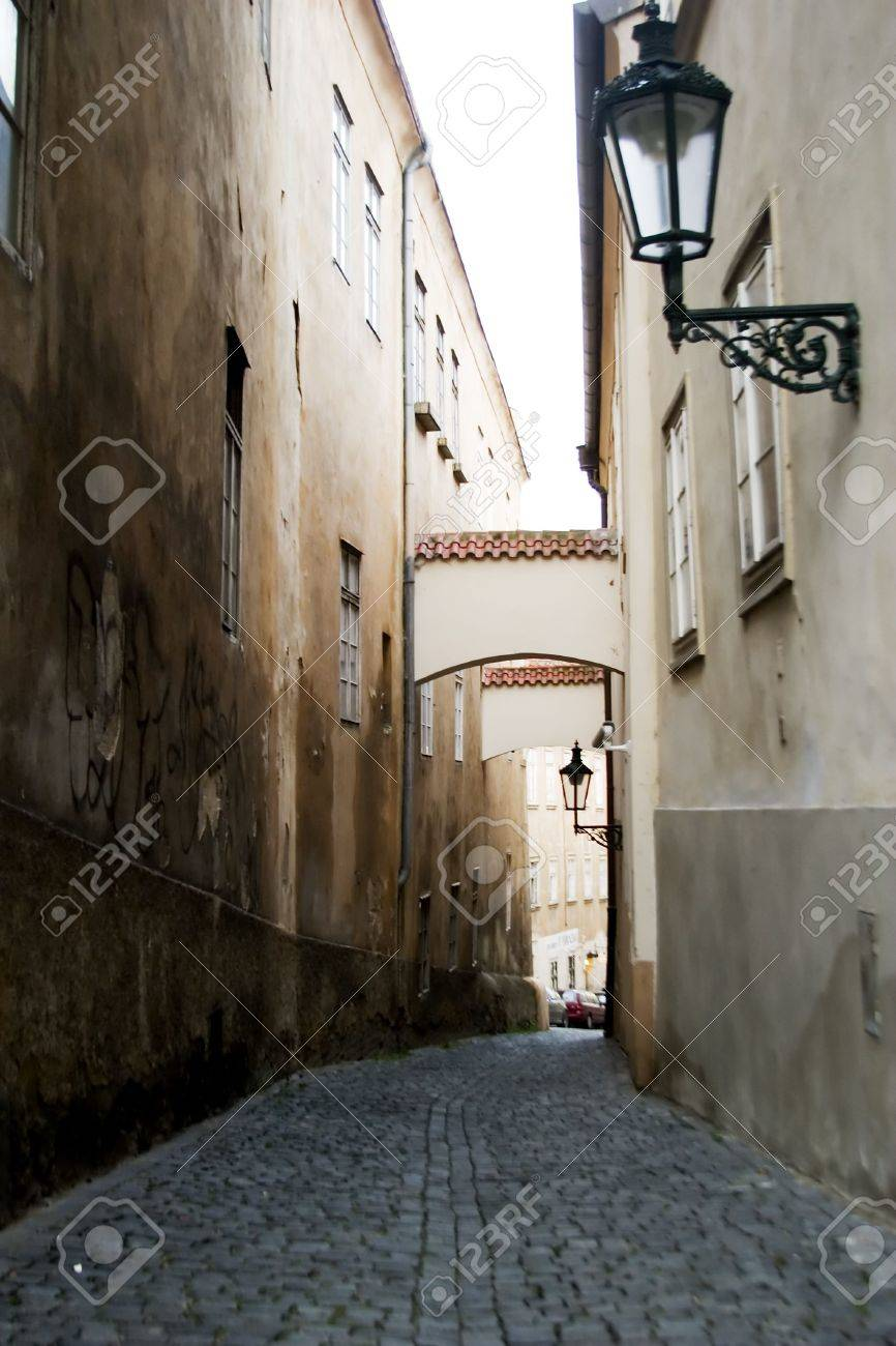 A dark moody image of a small skinny street in the old town area of Prague, Czech Republic. Stock Photo - 358009
