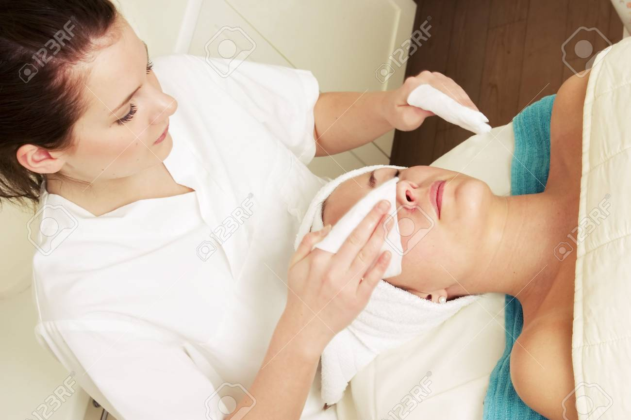 Lotion being massaged of the face at a beauty spa during a facial Stock Photo - 378788