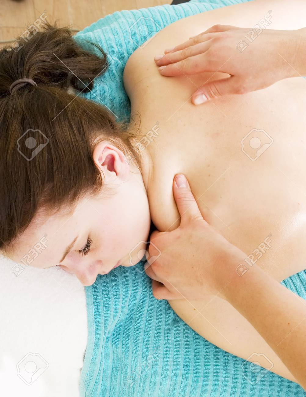 A female receives a shoulder massage at a day spa. Stock Photo - 378663