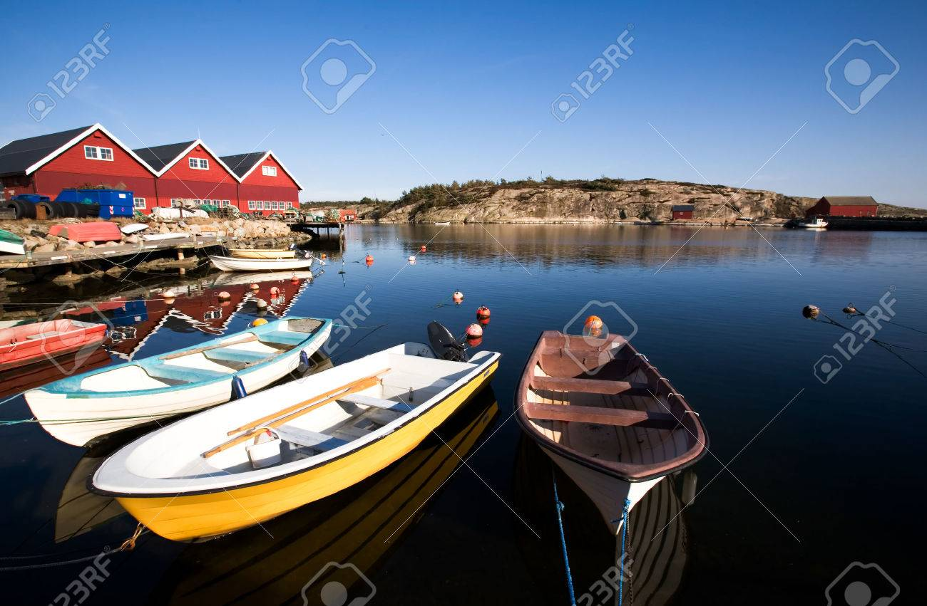 a group of small row boats tied to the dock stock photo picture