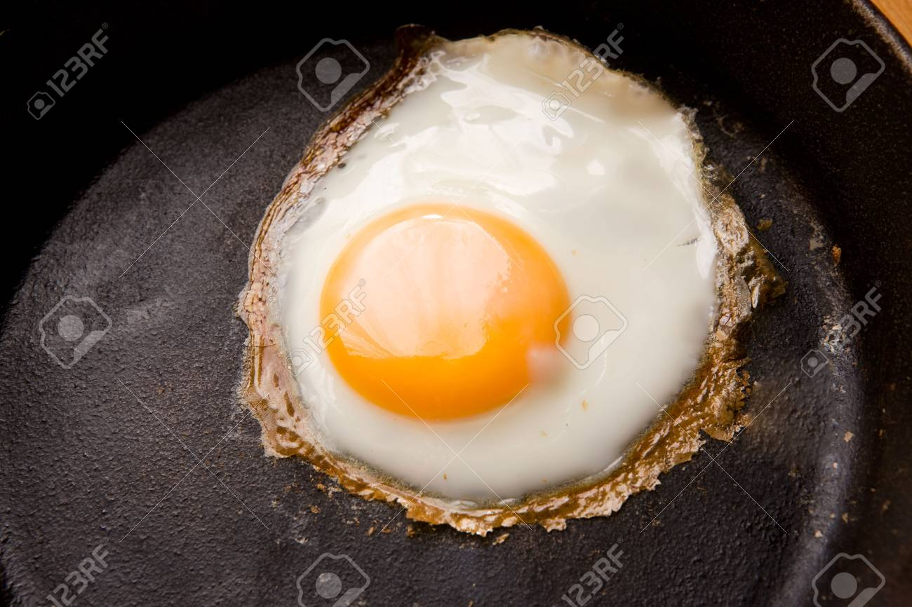 Detail image of a fried egg on a cast iron frying pan Stock Photo - 1894899