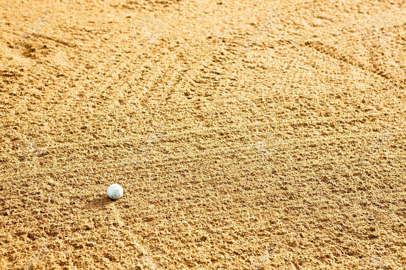 A golf ball in a sand trap Stock Photo - 3418758