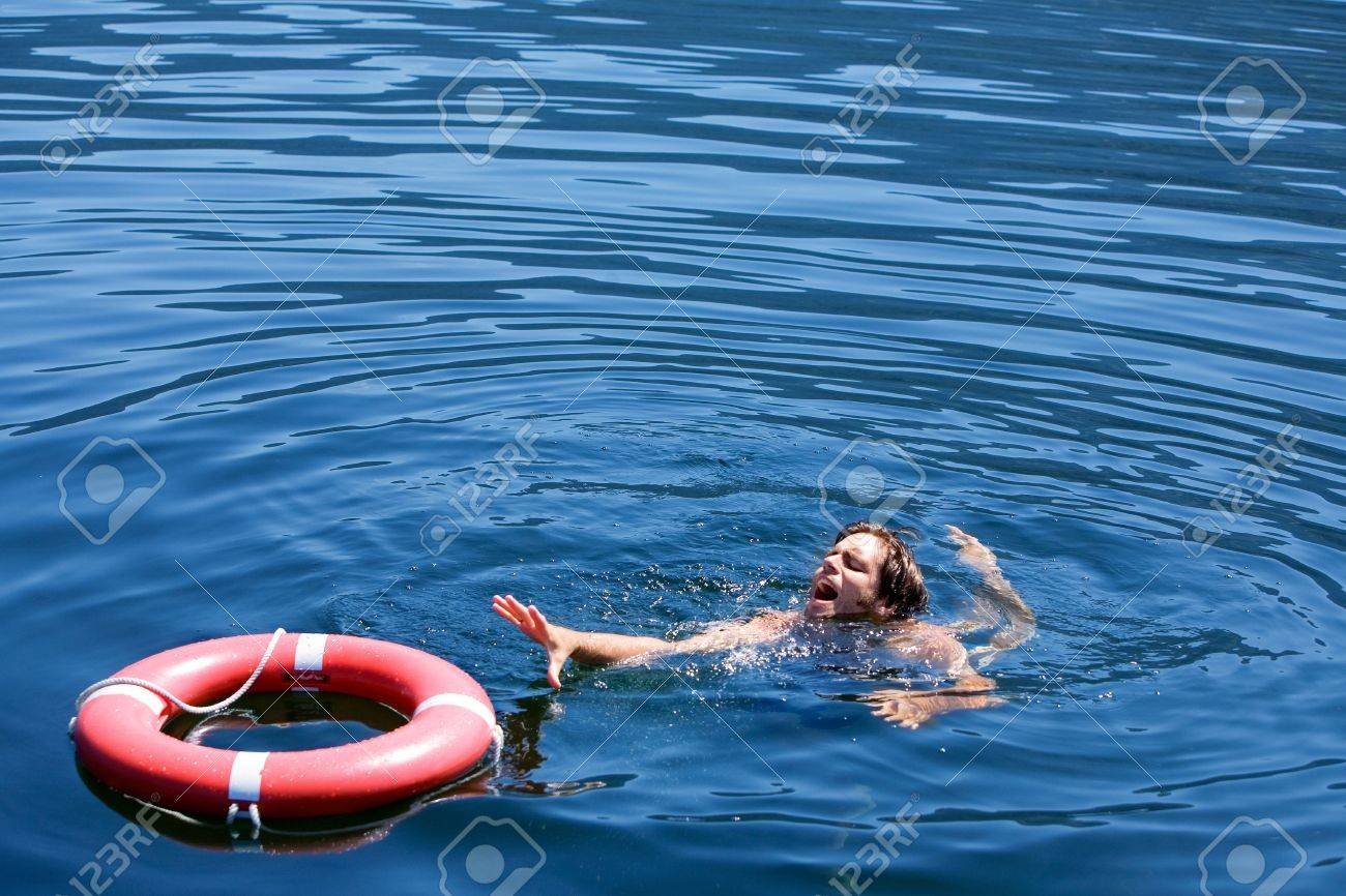 A man struggling for a life buoy in the water Stock Photo - 3457507