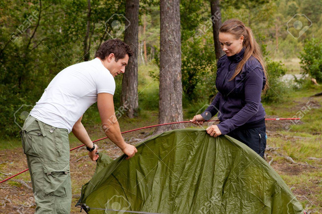 A man and woman setting up a tent in the forest Stock Photo - 5407079  sc 1 st  123RF Stock Photos & A Man And Woman Setting Up A Tent In The Forest Stock Photo ...