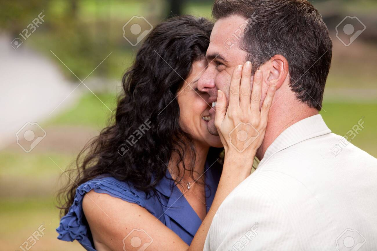 A couple in the park - having fun and relaxing Stock Photo - 5898079