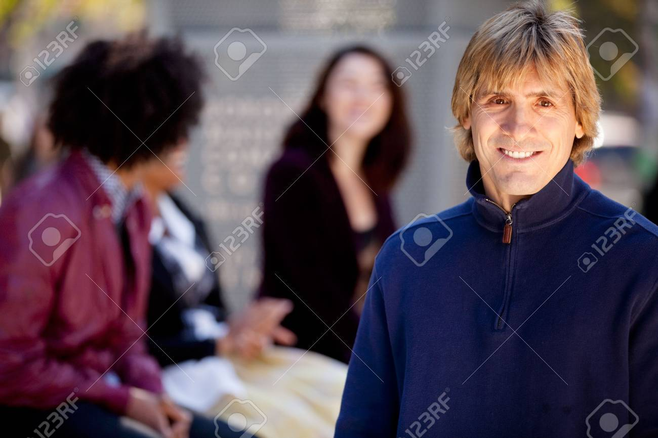 A portrait of a young man and a group of friends Stock Photo - 5971803