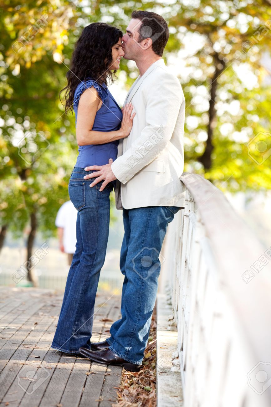 A man kissing a woman on the forehead Stock Photo - 5971870