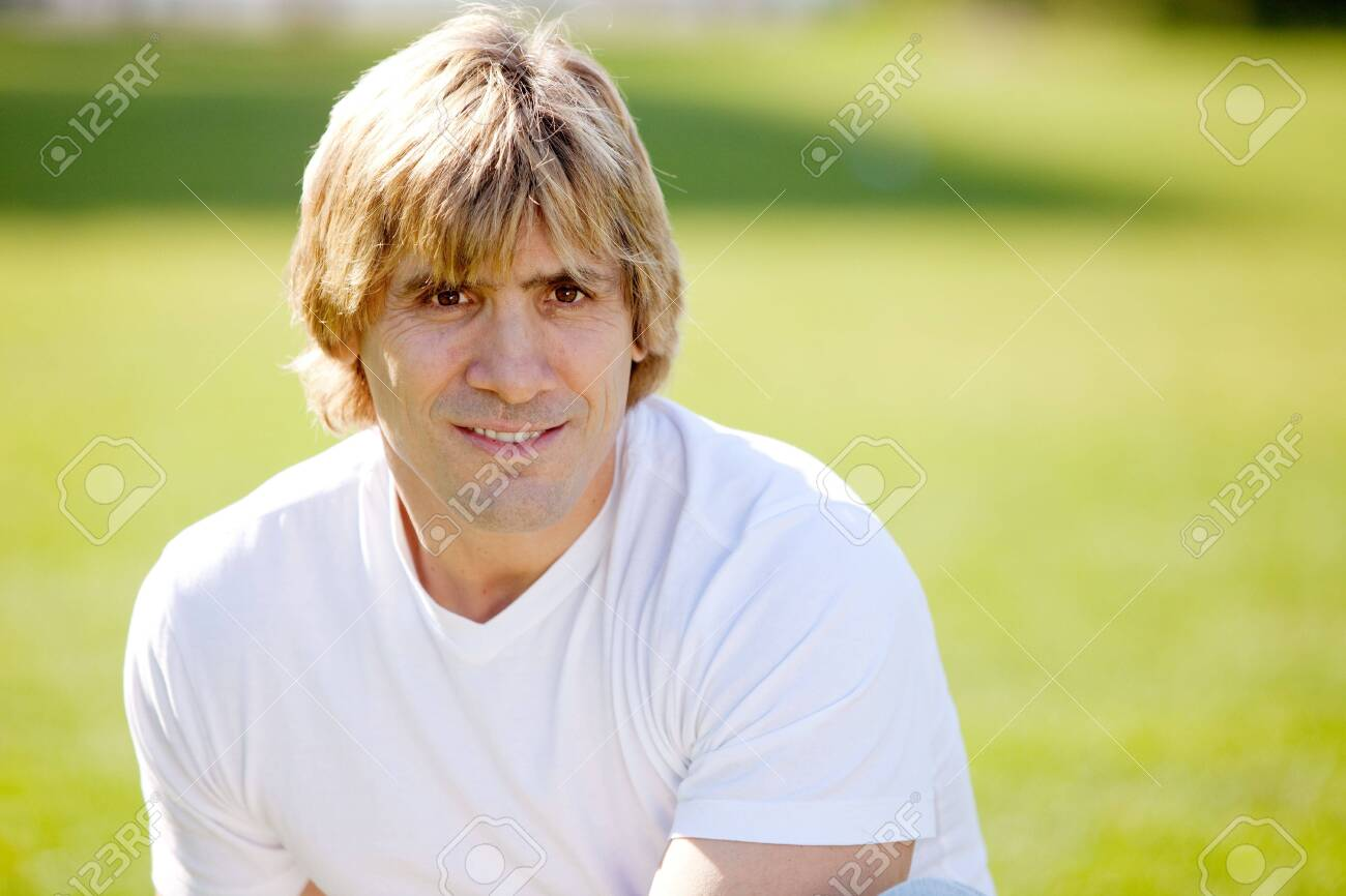 A happy confident male outside in a park Stock Photo - 5981902