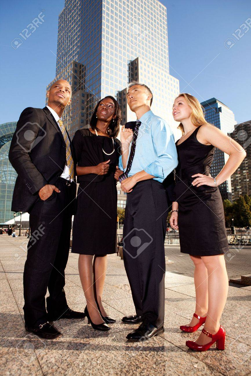 Four business people looking up. Horizontally framed shot. Stock Photo - 6105694