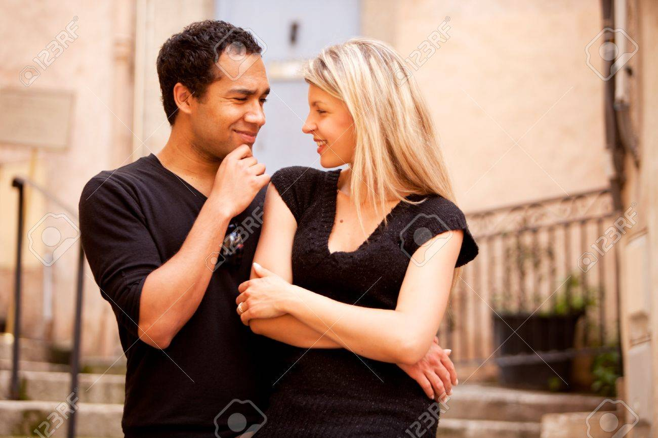 A Man Asking A Question To A Woman Stock Photo  Picture And