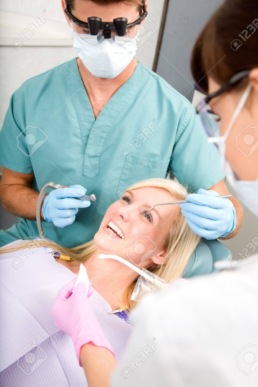 A woman at the dentist about to have some drilling done Stock Photo - 7690848