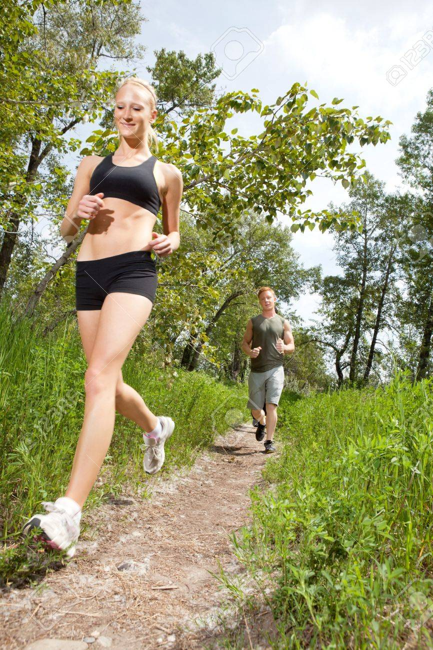 Young man and woman running on a pathway Stock Photo - 9290569