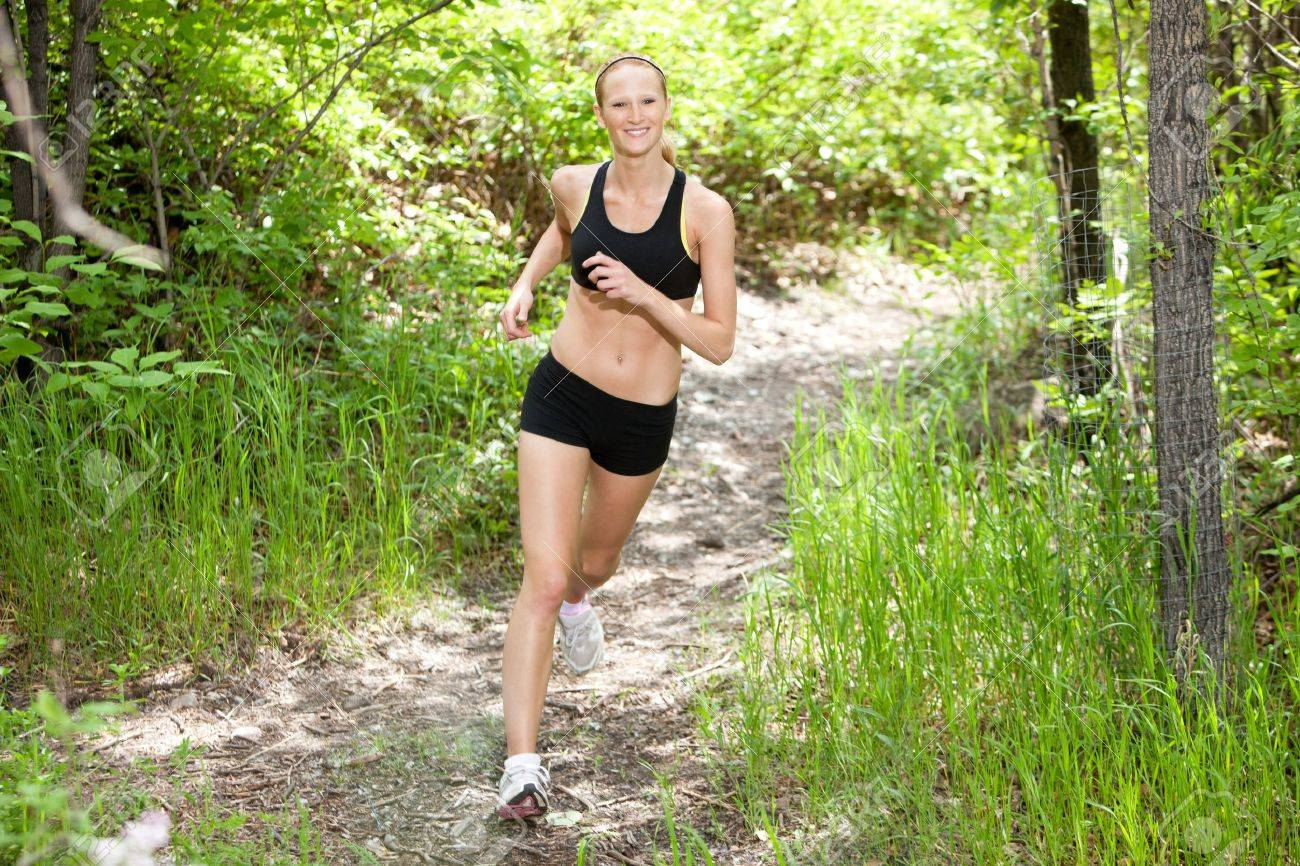 Portrait of beautiful young woman running in the forest Stock Photo - 9283509